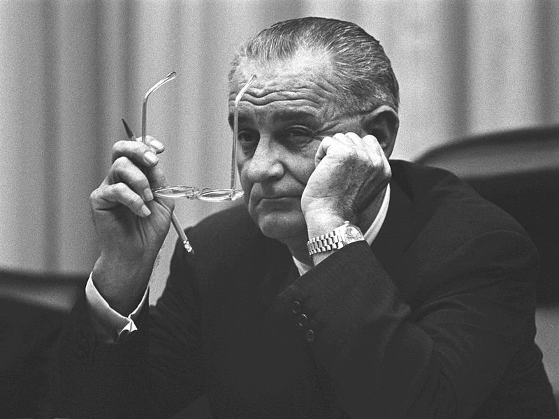 What caused President Johnson's escalation of the Vietnam War?